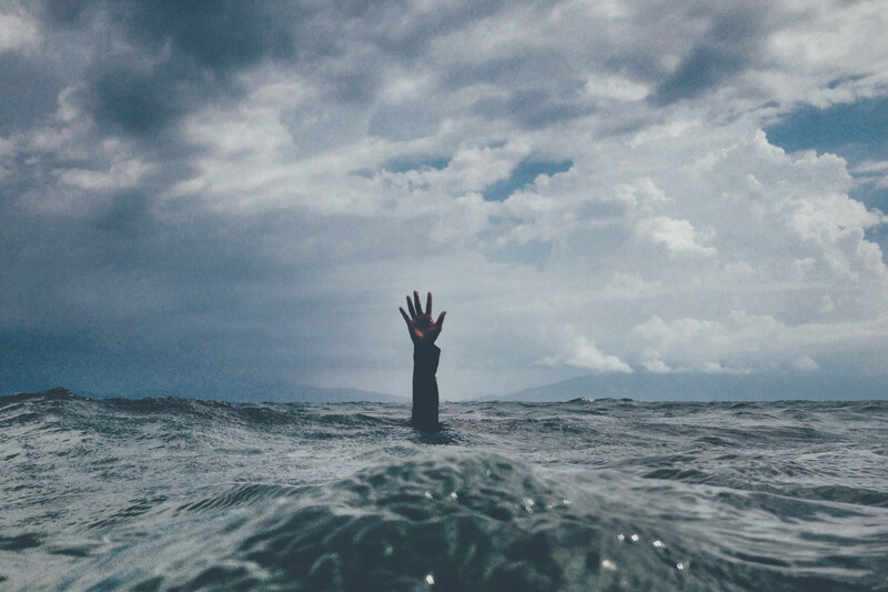 drowning in the ocean portraying frustration